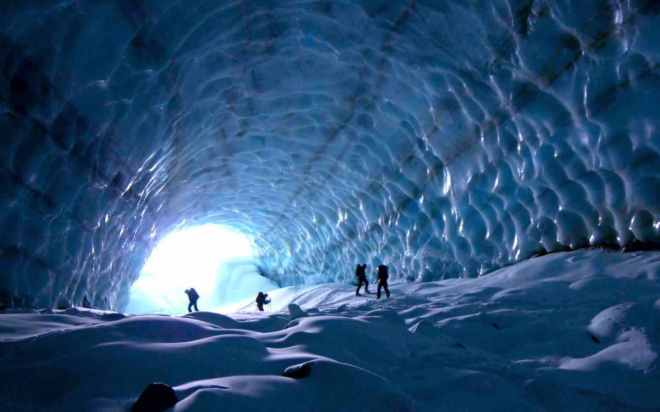 hikers in ice cave