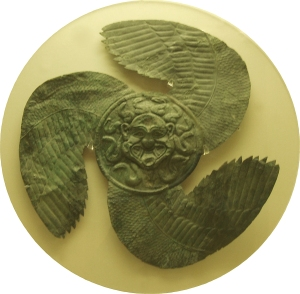 Winged Gorgoneion from Olympia, originally an apotropaic shield decoration, early sixth century BC (Wikimedia)