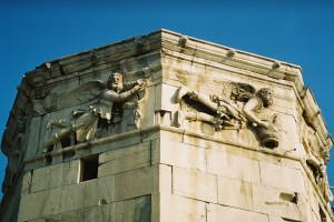 The Tower of the Winds, with the frieze showing the wind gods Boreas (north wind, on the left) and Skiron (northwesterly wind, on the right) Wikimedia.