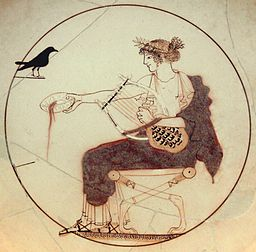 Apollo holding a lyre and pouring a libation, accompanied by a black bird. From a tomb at Delphi. Wikimedia.